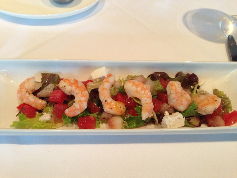 Tomato and Watermelon salad with chilled olive oil poached shrimp, feta cheese and baby greens