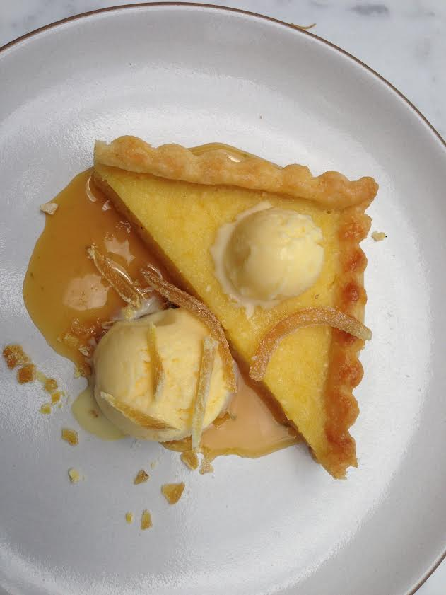 Lemon tart with rosemary shortbread crust, candied lemon and buttermilk ice cream