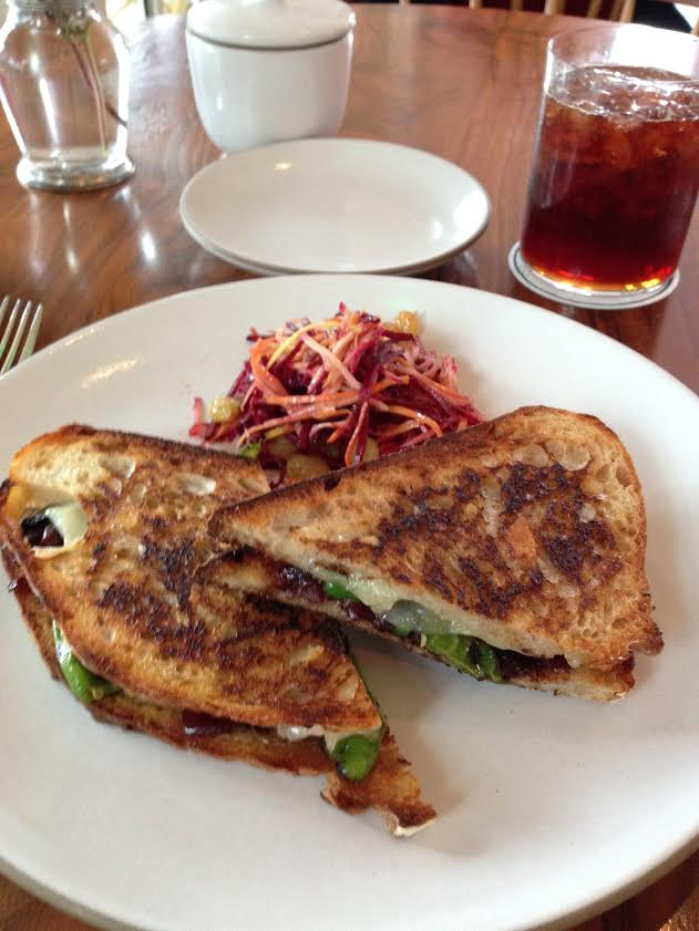 Manchego grilled cheese with red onion jam, grain mustard, blistered shisito peppers, sourdough, root vegetable slaw