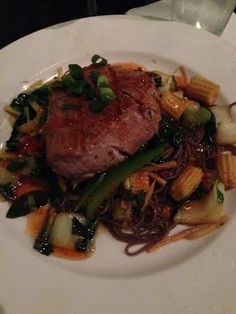 Asian Grilled Yellowfin Tuna served over Soba Noodles and Asian Vegetables, topped with a sweet Thai Chili sauce